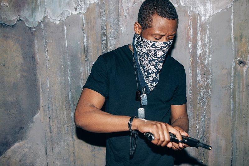 Black,gang,member,checks,his,weapon.,gangster,man,with,gun